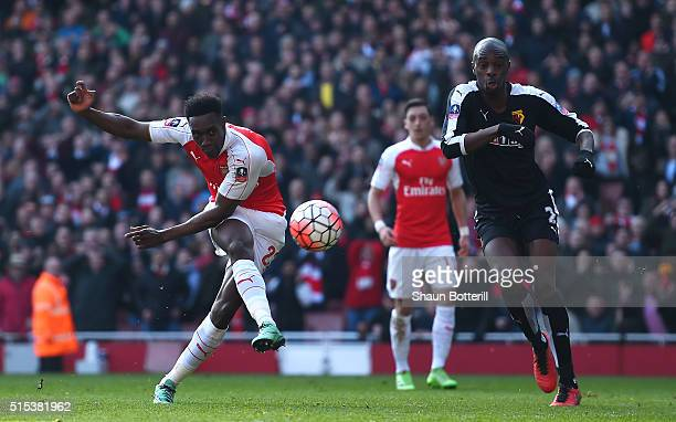 Danny Welbeck of Arsenal misses a chance as AllanRomeo Nyom of Watford looks on during the Emirates FA Cup sixth round match between Arsenal and...