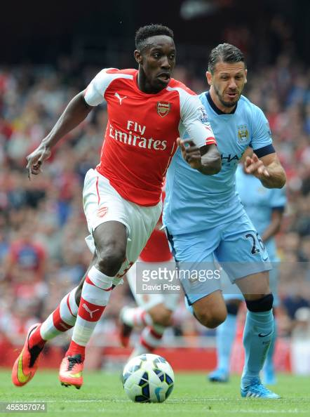 Danny Welbeck of Arsenal races away from Martin Demichelis of Manchester City during the Barclays Premier League match between Arsenal and Manchester...