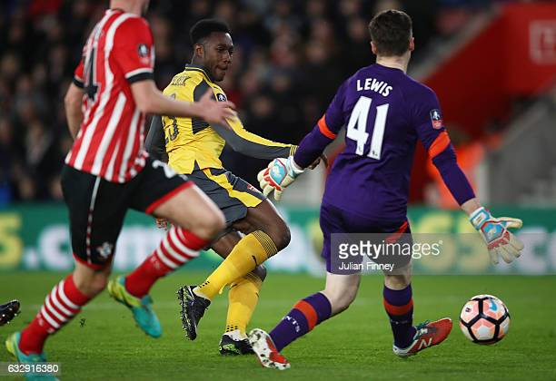 Danny Welbeck of Arsenal scores his and his sides second goal past Harry Lewis of Southampton during the Emirates FA Cup Fourth Round match between...