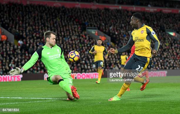 Danny Welbeck of Arsenal scores his sides first goal past Simon Mignolet of Liverpool during the Premier League match between Liverpool and Arsenal...