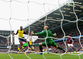 Danny Welbeck of Arsenal scores his team's second goal during the Barclays Premier League match between Aston Villa and Arsenal at Villa Park on...