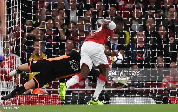 Danny Welbeck of Arsenal scores his team's second goal past Kasper Schmeichel of Leicester City during the Premier League match between Arsenal and...