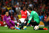 Danny Welbeck of Arsenal scores the opening goal past Fernando Muslera of Galatasaray AS during the UEFA Champions League group D match between...