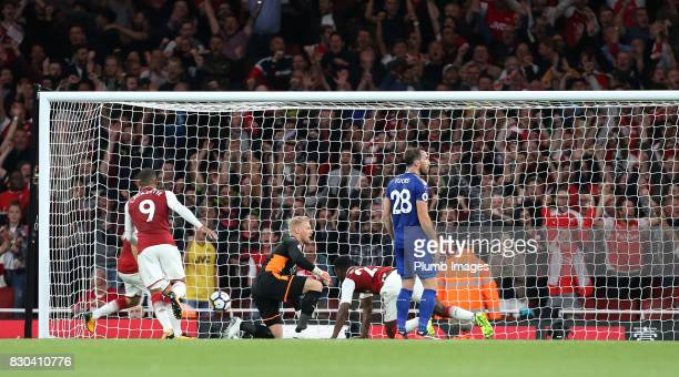 Danny Welbeck of Arsenal scores to make it 22 during the Premier League match between Arsenal and Leicester City at Emirates Stadium on August 11th...