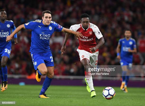 Danny Welbeck of Arsenal takes o Matty James of Leicester during the Premier League match between Arsenal and Leicester City at Emirates Stadium on...