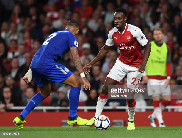 Danny Welbeck of Arsenal takes on Danny Simpson of Leicester during the Premier League match between Arsenal and Leicester City at Emirates Stadium...