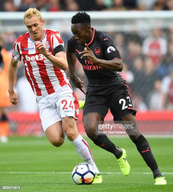 Danny Welbeck of Arsenal takes on Darren Fletcher of Stoke during the Premier League match between Stoke City and Arsenal at Bet365 Stadium on August...