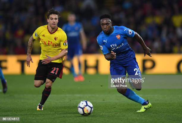 Danny Welbeck of Arsenal takes on Kiko Femenia of Watford during the Premier League match between Watford and Arsenal at Vicarage Road on October 14...