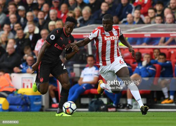 Danny Welbeck of Arsenal takes on Kurt Zouma of Stoke during the Premier League match between Stoke City and Arsenal at Bet365 Stadium on August 19...