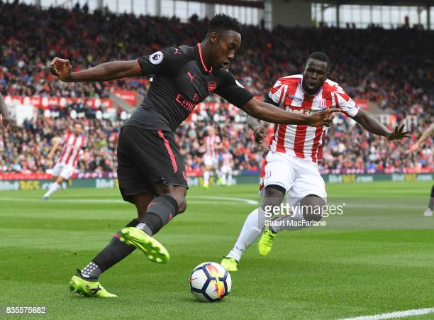 Danny Welbeck of Arsenal takes on Mame Diouf of Stoke during the Premier League match between Stoke City and Arsenal at Bet365 Stadium on August 19...