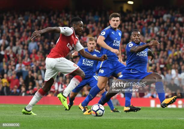 Danny Welbeck of Arsenal takes on Wes Morgan of Leicester during the Premier League match between Arsenal and Leicester City at Emirates Stadium on...