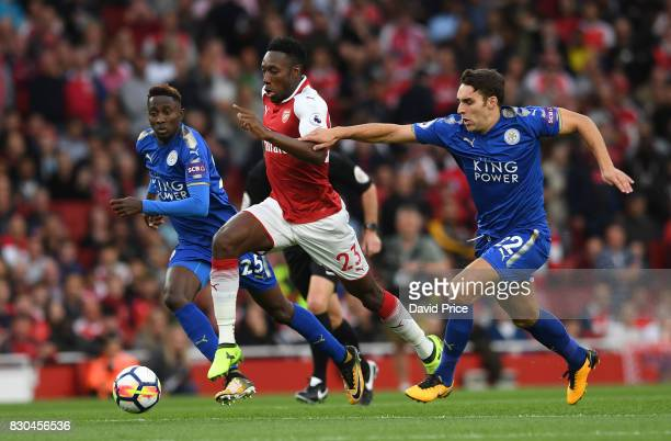 Danny Welbeck of Arsenal takes on Wilfred Ndidi and Matty James of Leicester during the Premier League match between Arsenal and Leicester City at...