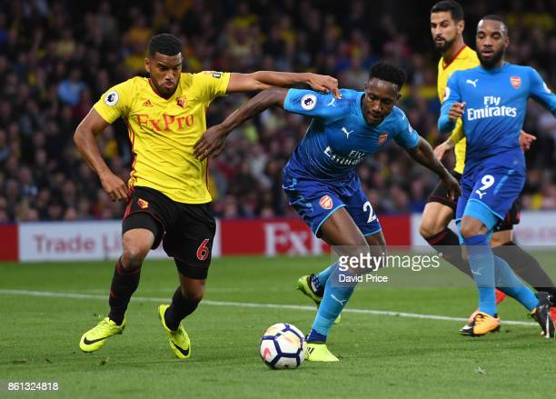 Danny Welbeck of Arsenal under pressure from Adrian Mariappa of Watford during the Premier League match between Watford and Arsenal at Vicarage Road...