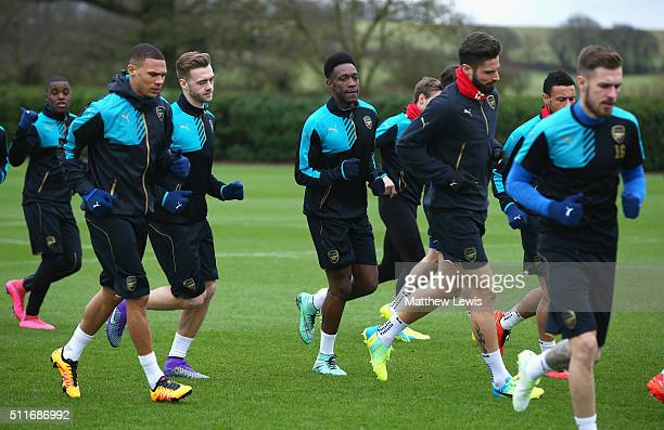 Danny Welbeck of Arsenal warms up with team mates during the Arsenal training session ahead of the UEFA Champions League match against Barcelona at...
