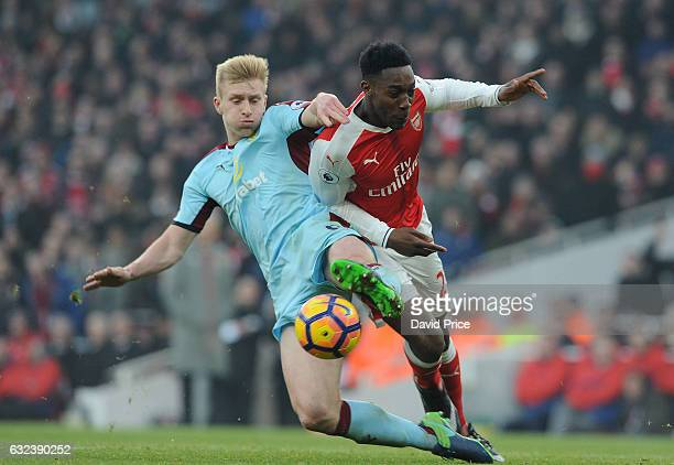 Danny Welbeck of Arsenalis challenged by Ben Mee of Burnley during the Premier League match between Arsenal and Burnley at Emirates Stadium on...