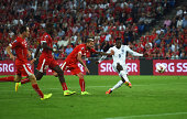 Danny Welbeck of England beats the Switzerland defence to score their second goal during the UEFA EURO 2016 Group E qualifying match between...