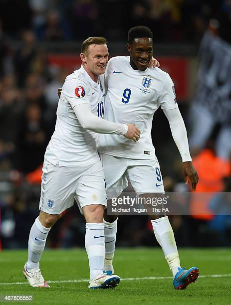 Danny Welbeck of England celebrates scoring their second goal with Wayne Rooney of England during the EURO 2016 Qualifier between England and...