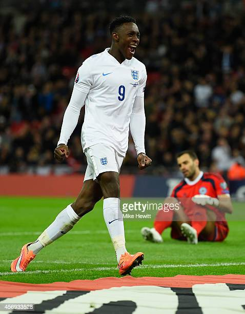 Danny Welbeck of England celebrates scoring their third goal as goalkeeper Aldo Simoncini of San Marino looks dejected during the EURO 2016 Group E...