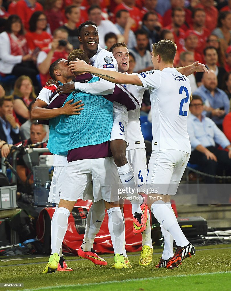 Danny Welbeck of England celebrates with team mates Alex OxladeChamberlain Calum Chambers Jordan Henderson and John Stones as he scores their first...