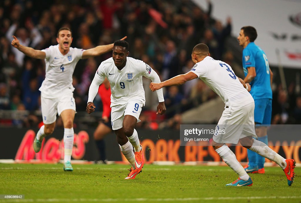 Danny Welbeck of England celebrates with team mates as he scores their second goal during the EURO 2016 Qualifier Group E match between England and...