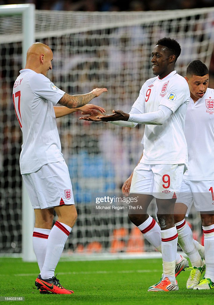 <a gi-track='captionPersonalityLinkClicked' href=/galleries/search?phrase=Danny+Welbeck&family=editorial&specificpeople=4223930 ng-click='$event.stopPropagation()'>Danny Welbeck</a> (R) of England celebrates with teammate <a gi-track='captionPersonalityLinkClicked' href=/galleries/search?phrase=Jonjo+Shelvey&family=editorial&specificpeople=4940315 ng-click='$event.stopPropagation()'>Jonjo Shelvey</a> of England after scoring his team's fourth goal during the FIFA 2014 World Cup Group H qualifying match between England and San Marino at Wembley Stadium on October 12, 2012 in London, England.