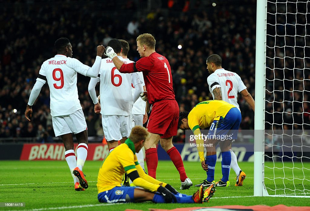 Danny Welbeck of England (L) congratulates team-mate Joe Hart of England after he saved the penalty shot of Ronaldinho of Brazil during the International friendly between England and Brazil at Wembley Stadium on February 6, 2013 in London, England.