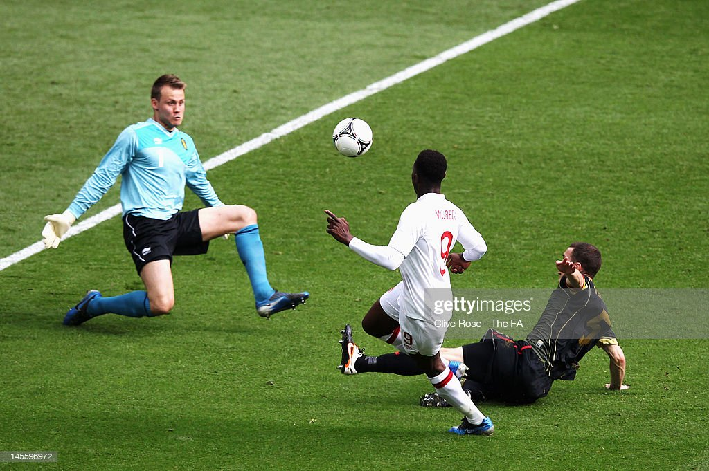 <a gi-track='captionPersonalityLinkClicked' href=/galleries/search?phrase=Danny+Welbeck&family=editorial&specificpeople=4223930 ng-click='$event.stopPropagation()'>Danny Welbeck</a> of England scores the opening goal during the International Friendly match between England and Belgium at Wembley Stadium on June 2, 2012 in London, England.