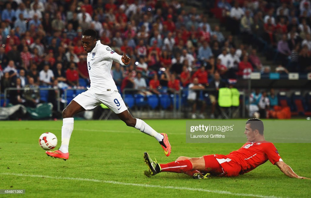 Danny Welbeck of England scores their first goal during the UEFA EURO 2016 Group E qualifying match between Switzerland and England at St JakobPark...