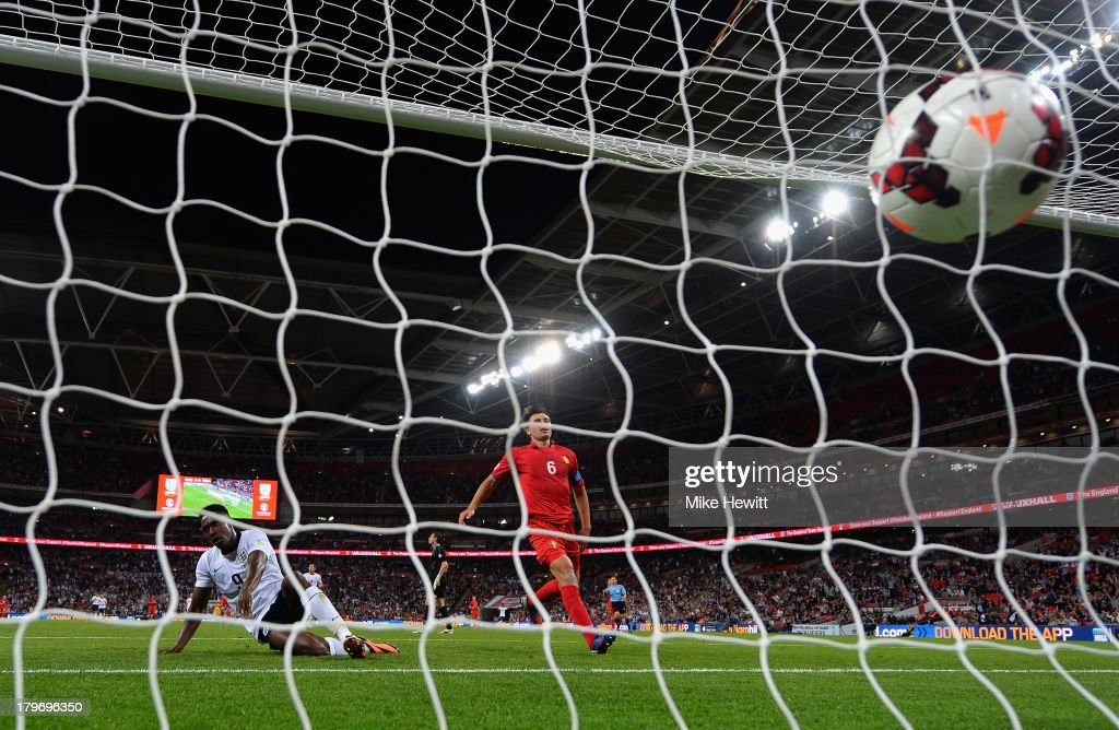 <a gi-track='captionPersonalityLinkClicked' href=/galleries/search?phrase=Danny+Welbeck&family=editorial&specificpeople=4223930 ng-click='$event.stopPropagation()'>Danny Welbeck</a> of England scores their third goal during the FIFA 2014 World Cup Qualifying Group H match between England and Moldova at Wembley Stadium on September 6, 2013 in London, England.