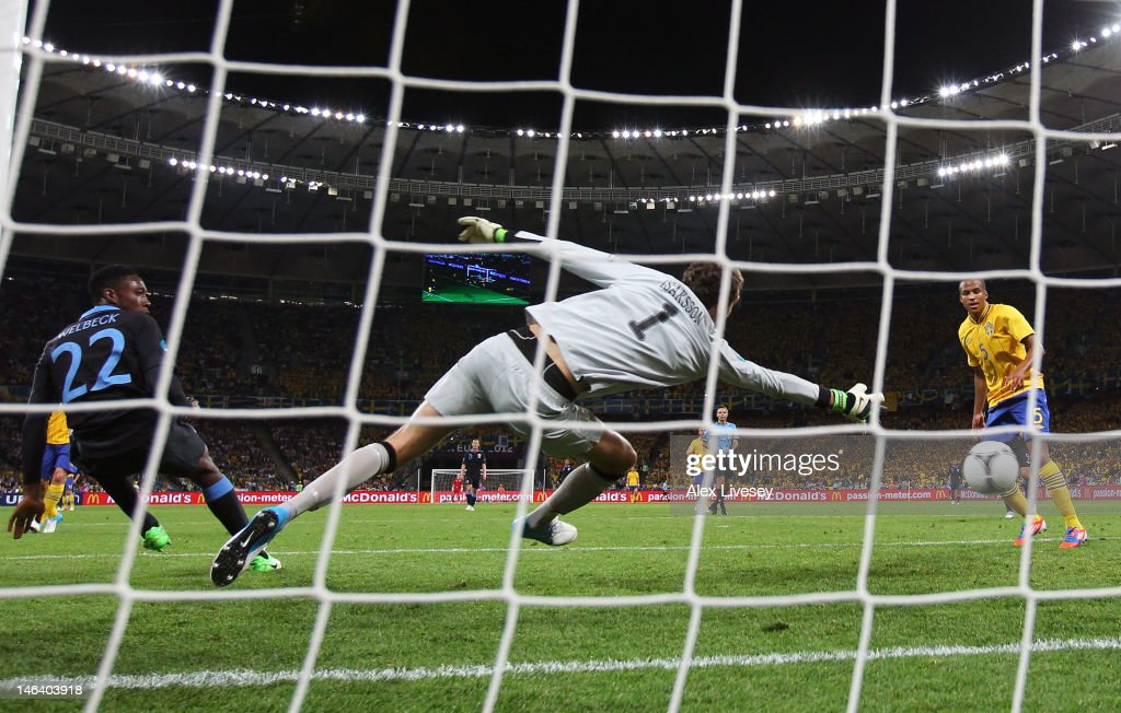 <a gi-track='captionPersonalityLinkClicked' href=/galleries/search?phrase=Danny+Welbeck&family=editorial&specificpeople=4223930 ng-click='$event.stopPropagation()'>Danny Welbeck</a> of England scores their third goal past <a gi-track='captionPersonalityLinkClicked' href=/galleries/search?phrase=Andreas+Isaksson&family=editorial&specificpeople=542896 ng-click='$event.stopPropagation()'>Andreas Isaksson</a> of Sweden during the UEFA EURO 2012 group D match between Sweden and England at The Olympic Stadium on June 15, 2012 in Kiev, Ukraine.
