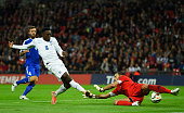 Danny Welbeck of England shoots past goalkeeper Aldo Simoncini of San Marino to score their third goal during the EURO 2016 Group E Qualifying match...