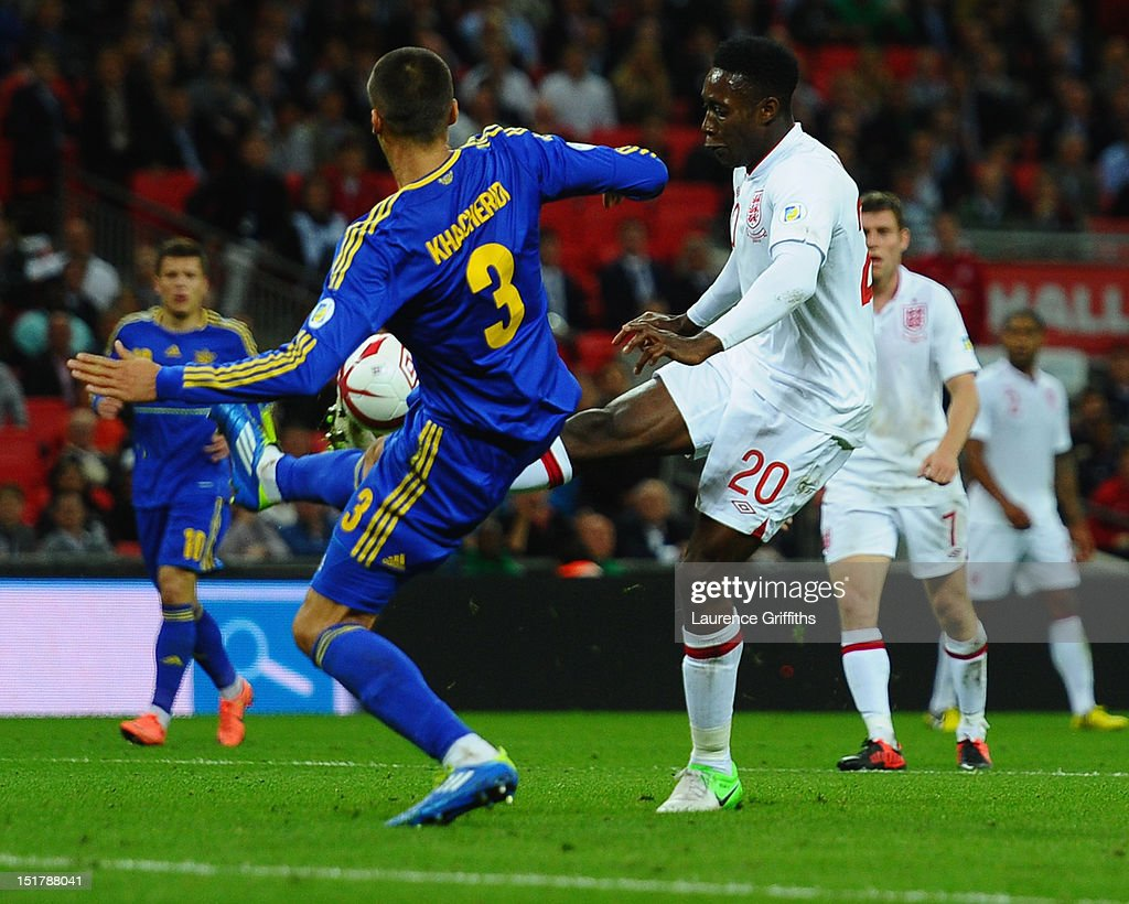 <a gi-track='captionPersonalityLinkClicked' href=/galleries/search?phrase=Danny+Welbeck&family=editorial&specificpeople=4223930 ng-click='$event.stopPropagation()'>Danny Welbeck</a> of England tries to knock the ball past <a gi-track='captionPersonalityLinkClicked' href=/galleries/search?phrase=Yevhen+Khacheridi&family=editorial&specificpeople=6340157 ng-click='$event.stopPropagation()'>Yevhen Khacheridi</a> of Ukraine who concedes a penalty during the FIFA 2014 World Cup Group H qualifying match between England and Ukraine at Wembley Stadium on September 11, 2012 in London, England.