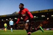 Danny Welbeck of Manchester United celebrates as he scores their first goal during the Barclays Premier League match between Norwich City and...