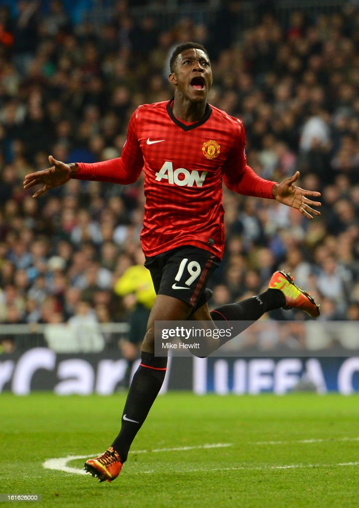 <a gi-track='captionPersonalityLinkClicked' href=/galleries/search?phrase=Danny+Welbeck&family=editorial&specificpeople=4223930 ng-click='$event.stopPropagation()'>Danny Welbeck</a> of Manchester United celebrates scoring the opening goal during the UEFA Champions League Round of 16 first leg match between Real Madrid and Manchester United at Estadio Santiago Bernabeu on February 13, 2013 in Madrid, Spain.