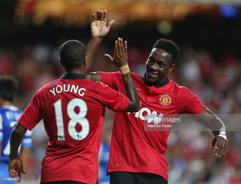 <a gi-track='captionPersonalityLinkClicked' href=/galleries/search?phrase=Danny+Welbeck&family=editorial&specificpeople=4223930 ng-click='$event.stopPropagation()'>Danny Welbeck</a> of Manchester United celebrates scoring ther first goal with <a gi-track='captionPersonalityLinkClicked' href=/galleries/search?phrase=Ashley+Young&family=editorial&specificpeople=623155 ng-click='$event.stopPropagation()'>Ashley Young</a> during the pre-season friendly match between Kitchee FC and Manchester United as part of their pre-season tour of Bangkok, Australia, Japan and Hong Kong at Hong Kong Stadium on July 29, 2013 in So Kon Po, Hong Kong.