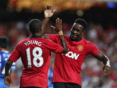 Danny Welbeck of Manchester United celebrates scoring ther first goal with Ashley Young during the preseason friendly match between Kitchee FC and...