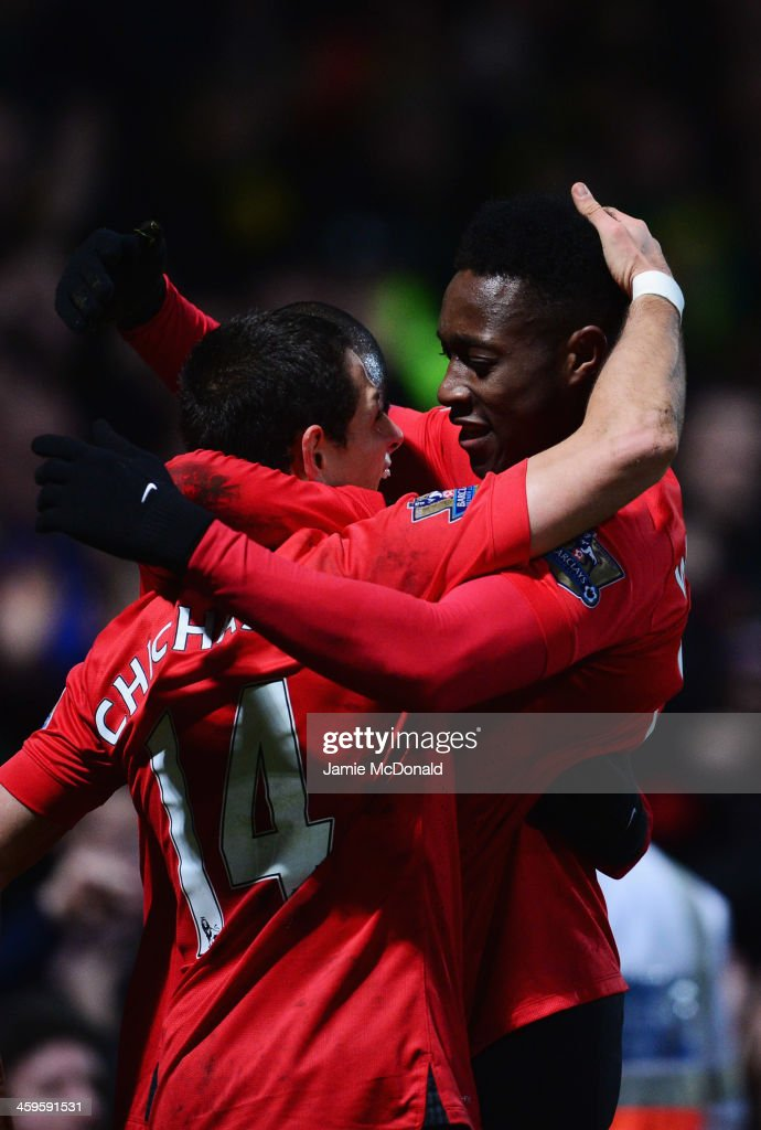 <a gi-track='captionPersonalityLinkClicked' href=/galleries/search?phrase=Danny+Welbeck&family=editorial&specificpeople=4223930 ng-click='$event.stopPropagation()'>Danny Welbeck</a> of Manchester United (R) celebrates with <a gi-track='captionPersonalityLinkClicked' href=/galleries/search?phrase=Javier+Hernandez+-+Soccer+Player&family=editorial&specificpeople=6733186 ng-click='$event.stopPropagation()'>Javier Hernandez</a> (14) as he scores their first goal during the Barclays Premier League match between Norwich City and Manchester United at Carrow Road on December 28, 2013 in Norwich, England.