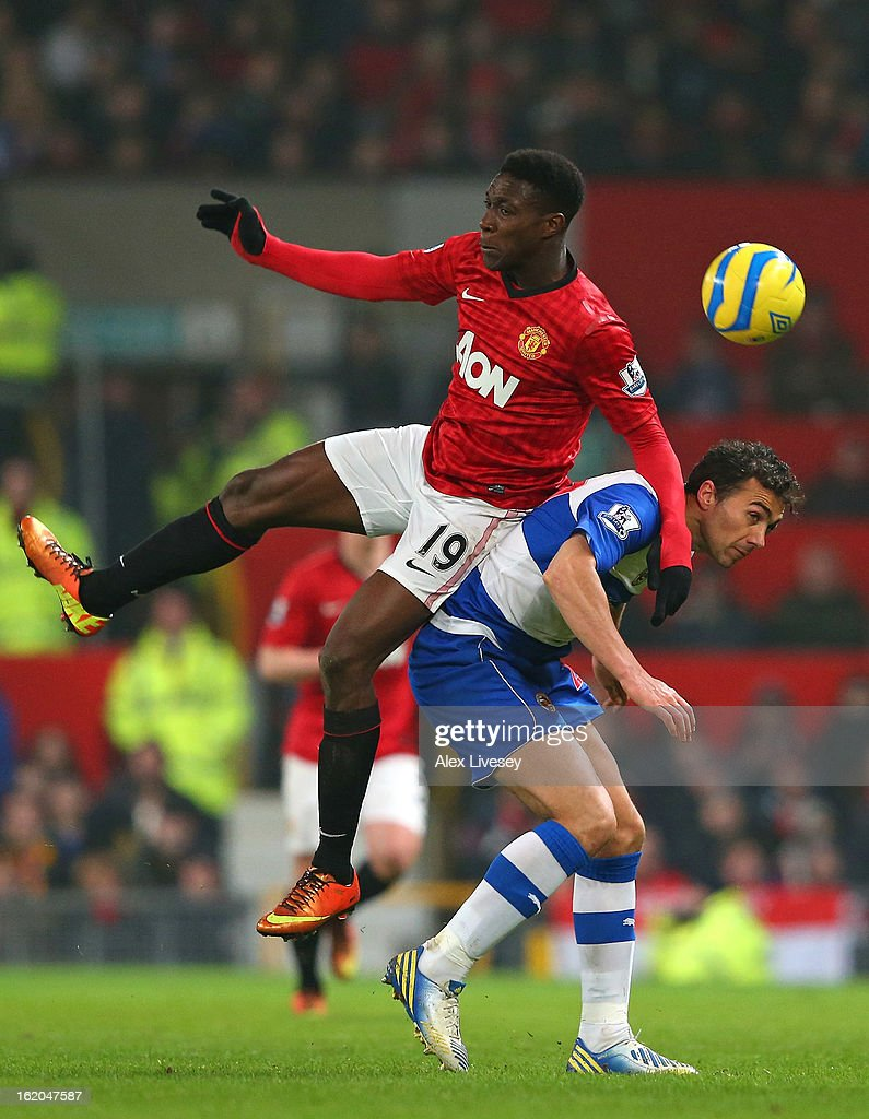 Danny Welbeck of Manchester United challenges Stephen Kelly of Reading during the FA Cup Fifth Round match between Manchester United and Reading at Old Trafford on February 18, 2013 in Manchester, England.