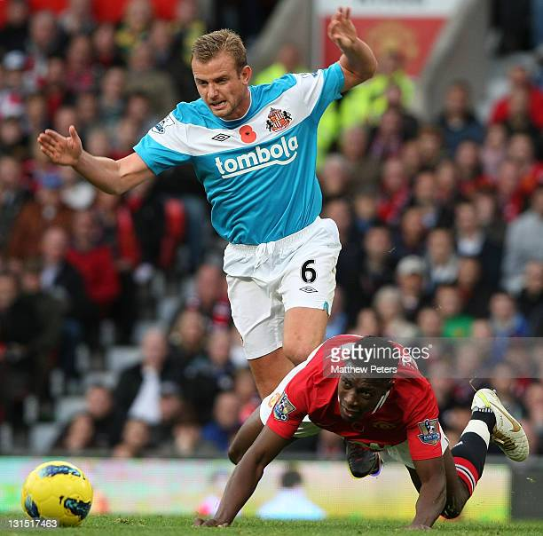 Danny Welbeck of Manchester United clashes with Lee Cattermole of Sunderland during the Barclays Premier League match between Manchester United and...