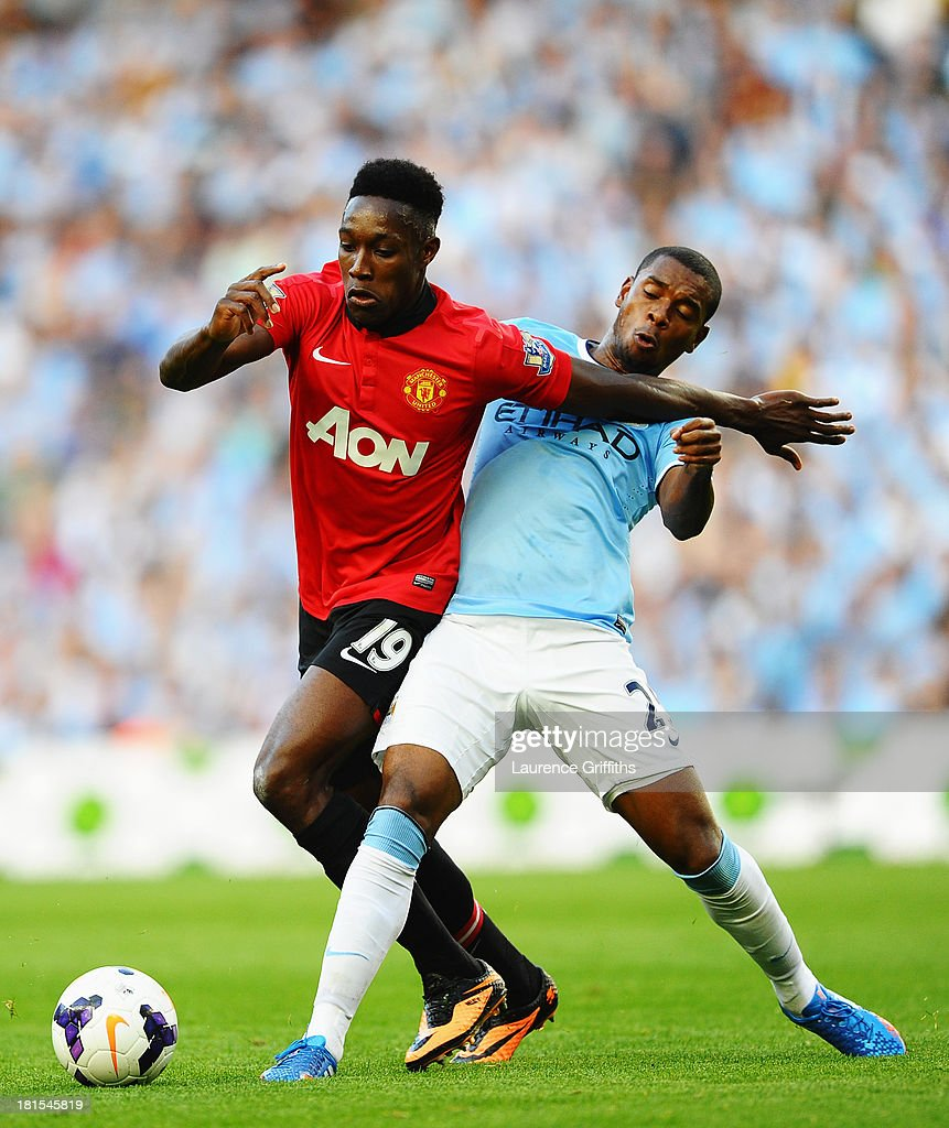 Danny Welbeck of Manchester United holds off Fernandinho of Manchester City during the Barclays Premier League match between Manchester City and Manchester United at the Etihad Stadium on September 22, 2013 in Manchester, England.