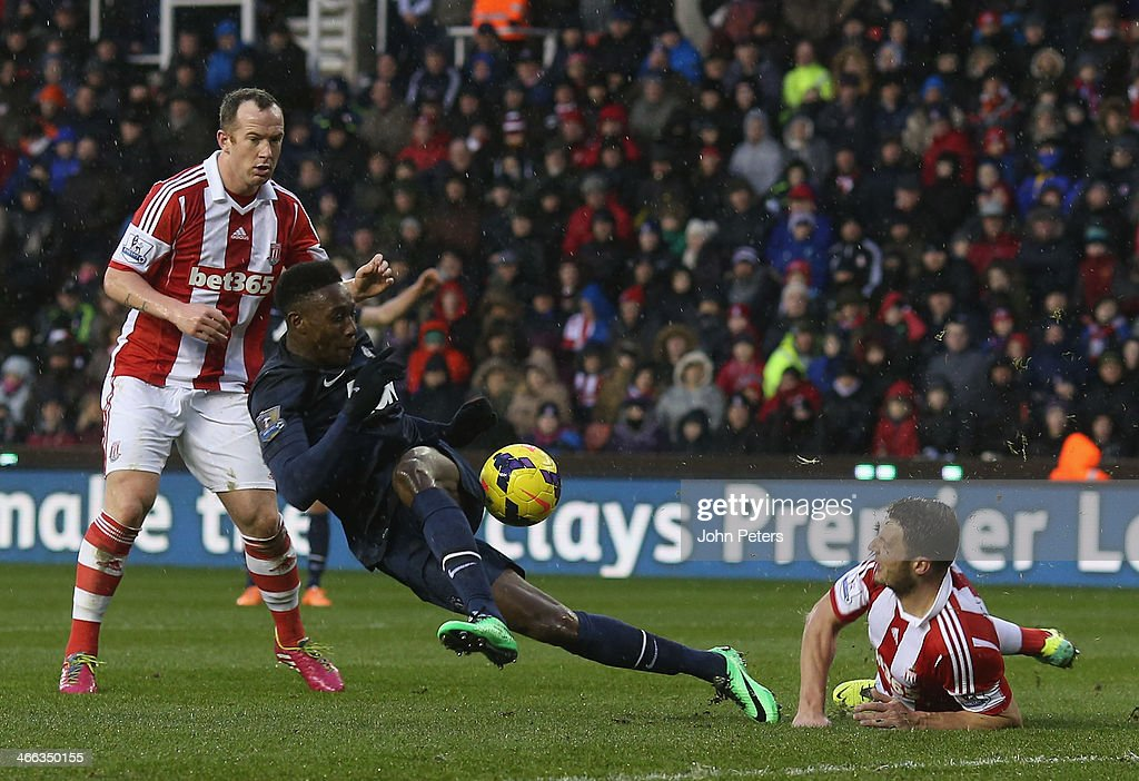 Danny Welbeck of Manchester United in action with Charlie Adam of Stoke City during the Barclays Premier League match between Stoke City and Manchester United at Britannia Stadium on February 1, 2014 in Stoke on Trent, England.