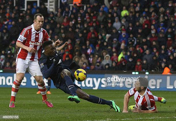 Danny Welbeck of Manchester United in action with Charlie Adam of Stoke City during the Barclays Premier League match between Stoke City and...