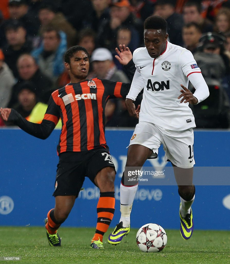 Danny Welbeck of Manchester United in action with Douglas Costa of Shakhtar Donetsk during the UEFA Champions League Group A match between Shakhtar Donetsk and Manchester United at Donbass Arena on October 2, 2013 in Donetsk, Ukraine.