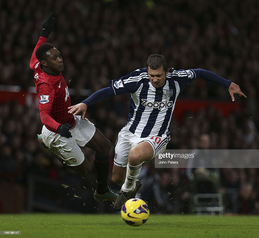 Danny Welbeck of Manchester United in action with Gabriel Tamas of West Bromwich Albion during the Barclays Premier League match between Manchester United and West Bromwich Albion at Old Trafford on December 29, 2012 in Manchester, England.