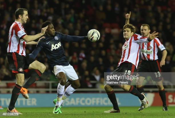 Danny Welbeck of Manchester United in action with John O'Shea and Emanuele Giaccherini of Sunderland during the Capital One Cup SemiFinal first leg...