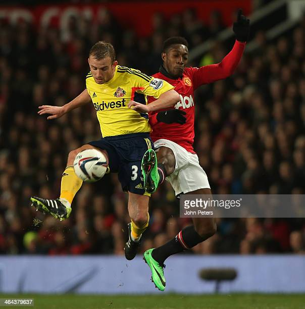 Danny Welbeck of Manchester United in action with Lee Cattermole of Sunderland during the Capital One Cup semifinal second leg at Old Trafford on...