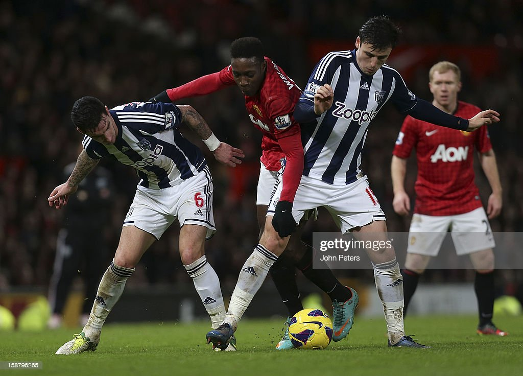 Danny Welbeck of Manchester United in action with Liam Ridgewell (L) and George Thorne of West Bromwich Albion during the Barclays Premier League match between Manchester United and West Bromwich Albion at Old Trafford on December 29, 2012 in Manchester, England.
