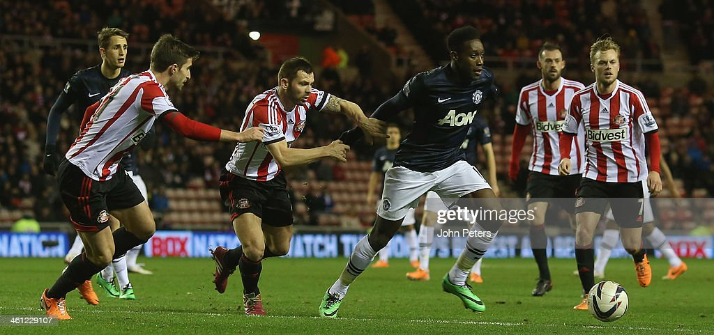Danny Welbeck of Manchester United in action with Phil Bardsley of Sunderland during the Capital One Cup Semi-Final first leg between Sunderland and Manchester United at Stadium of Light on January 7, 2014 in Sunderland, England.