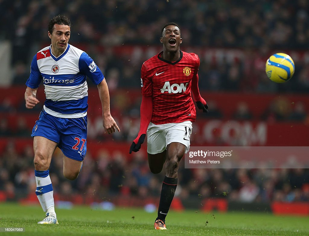 Danny Welbeck of Manchester United in action with Stephen Kelly of Reading during the FA Cup Fifth Round match between Manchester United and Reading at Old Trafford on February 18, 2013 in Manchester, England.