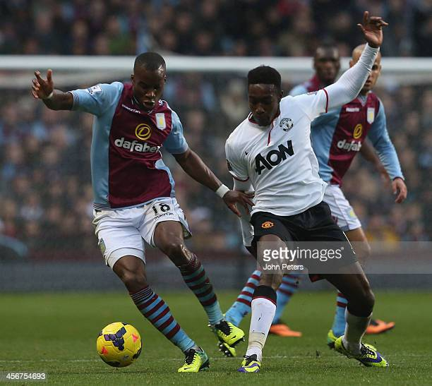 Danny Welbeck of Manchester United in action with Yacouba Sylla of Aston Villa during the Barclays Premier League match between Aston Villa and...